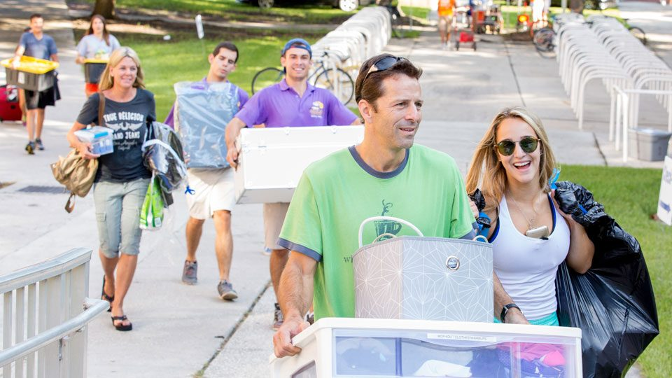 Parents helping students move in