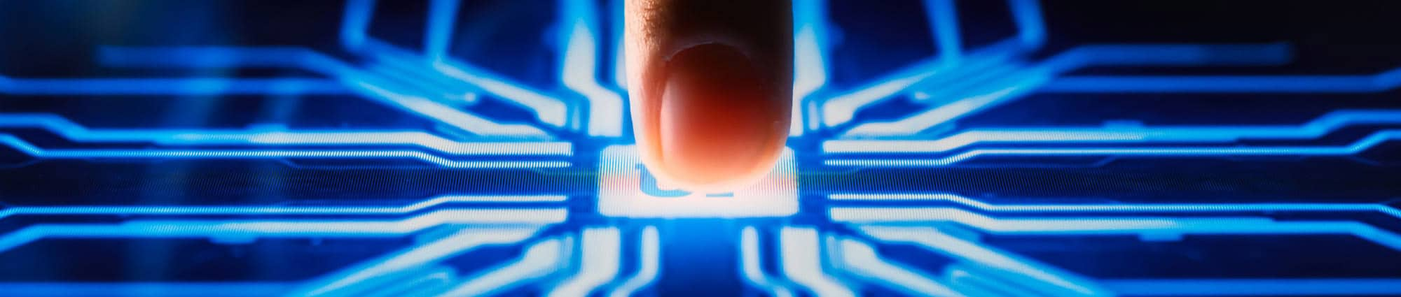 Close up of a fingertip touching what looks like a UF icon on a computer board.
