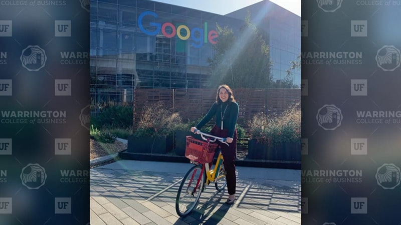 Nelly Wilson on a bike in front of the Google building