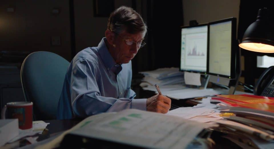 Warrington faculty, Jay Ritter working at his desk