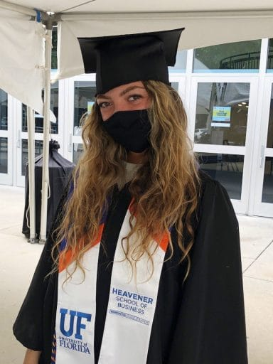 Laura Dominguez graduation photo with a mask on