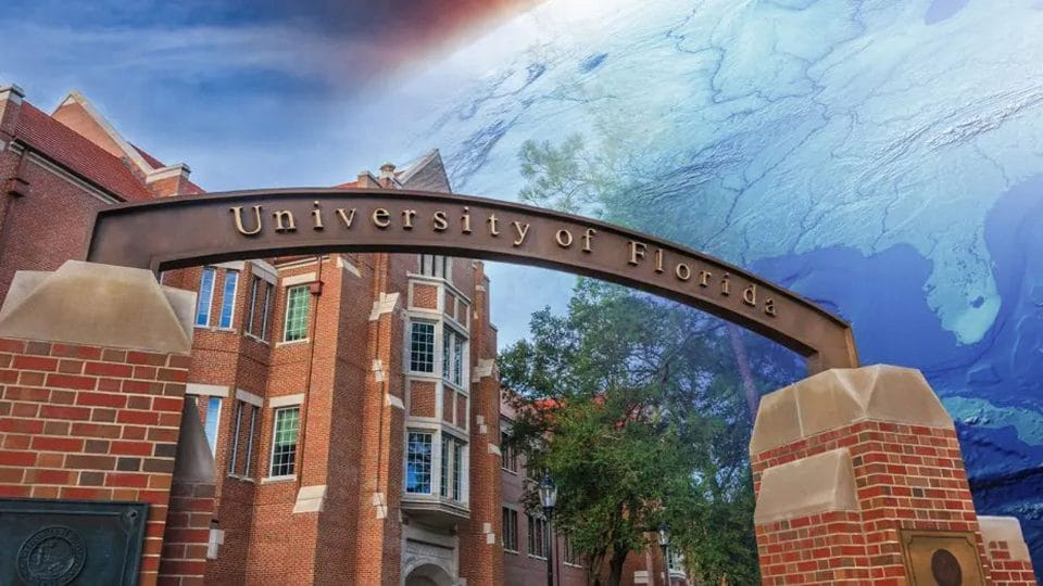 The University of Florida gateway with Heavener Hall in the background and the earth with Florida visible transposed in the sky