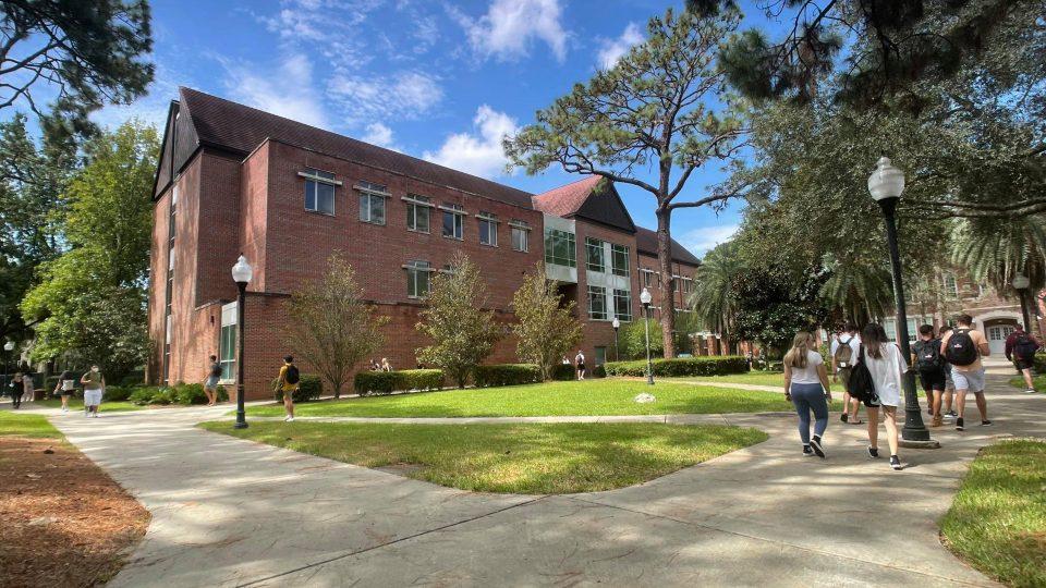 Students walking on sidewalks around Gerson Hall
