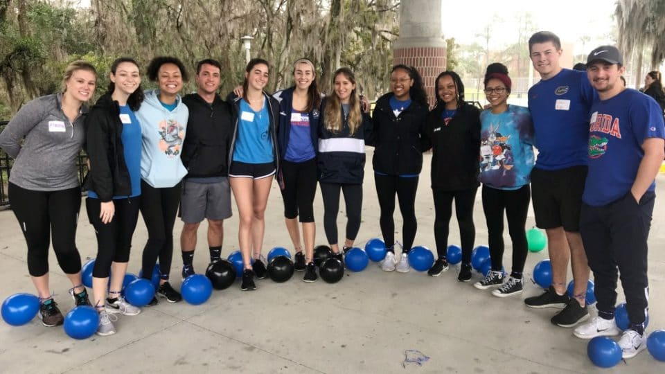 BUMP participants with balloons tied around their ankles