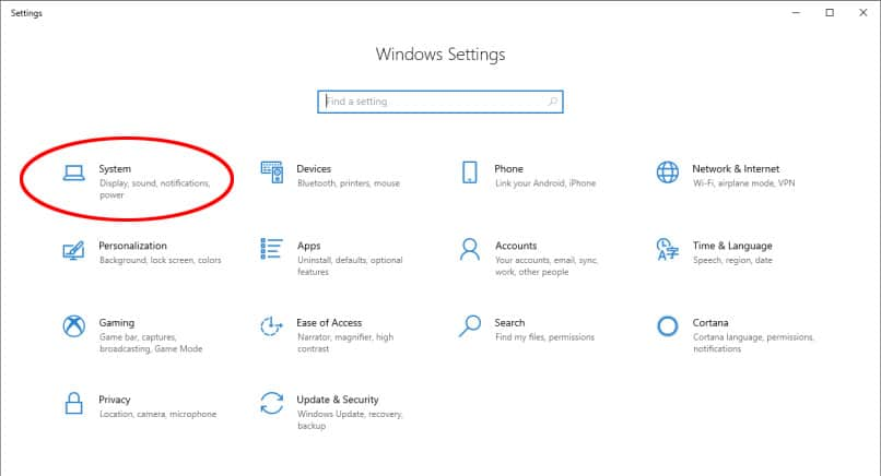 "Screen capture of Windows Settings screen with ""System"" circled"