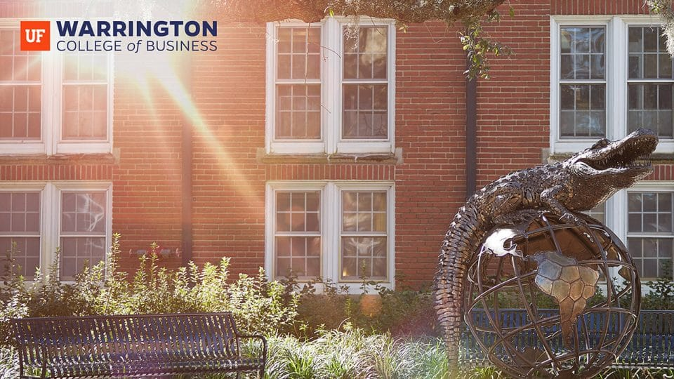 Photo of the Gator Ubiquity Statue and Bryan Hall in the background and the Warrington College of Business logo in the upper left