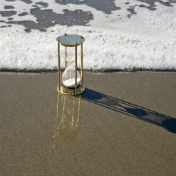 Hourglass on beach