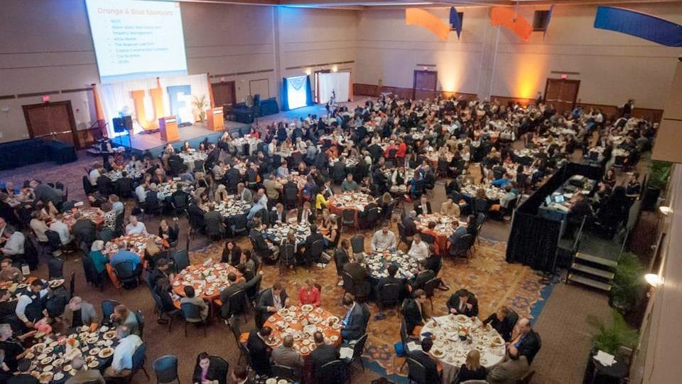 Tables of attendees fill Reitz Union Grand Ballroom