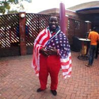 University of the Western Cape student with a U.S. flag wrapped around him