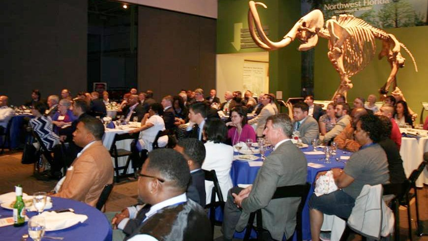 Tables of attendees fill a large room at the Harn Museum for the 2016 VEP opening ceremony