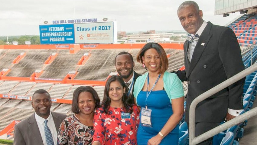 VEP 2017 delegate and family at the in the stadium with VEP Class of 2017 on the sign behind them