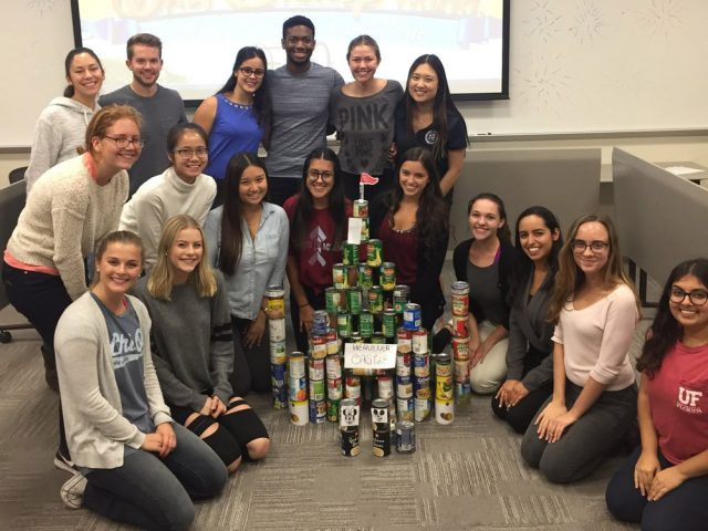 Students with their completed can project