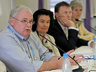 Robert Knechel with others on a panel