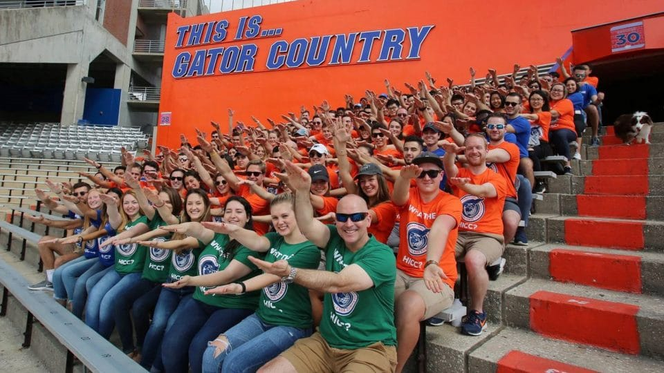 Sean Limon with the Heavener International Case Competition students in the stadium doing the Gator chomp