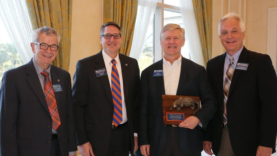 Dan Woodward receives award from Bergstrom center pictured with Wayne Archer, Tim Becker and David Ling