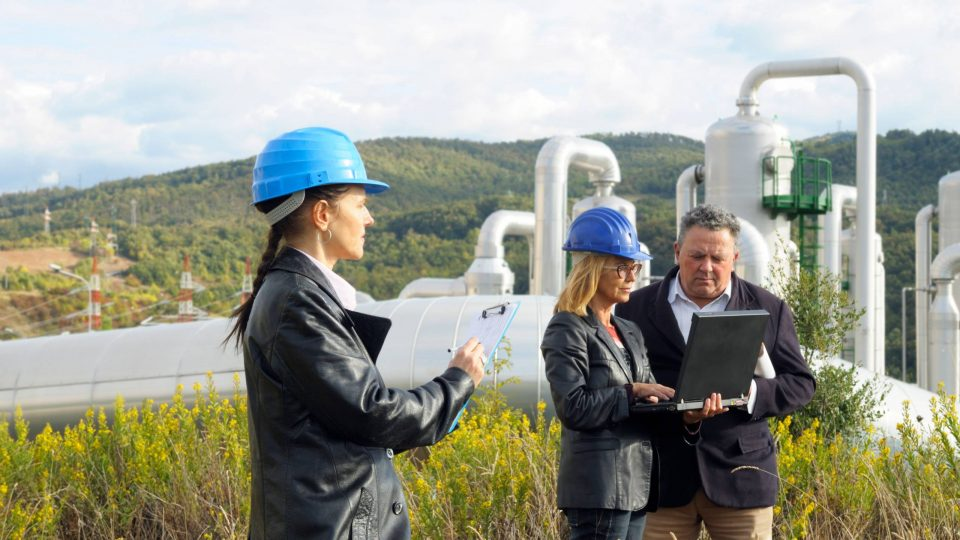 Three engineers planning in a geothermal power station
