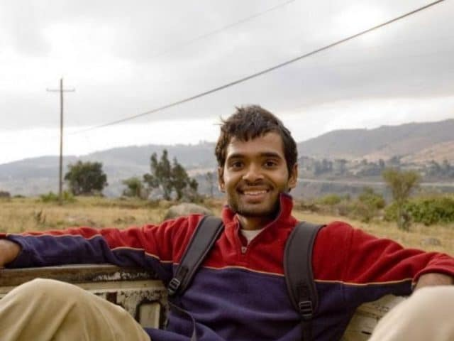 Abhi Lokesh riding in the back of a pickup