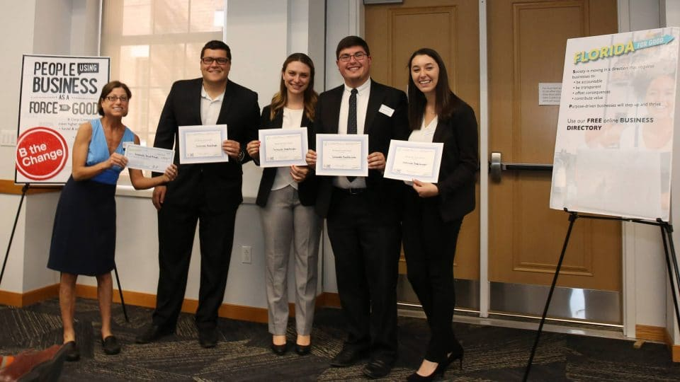UF Business for Good Lab: Sustainable Business Consulting for B Corp certification with Kristin Joys presenting award to Sustainable Breakthroughs team, founded by Gator Grad, Grant Kendzior in Spring 2019