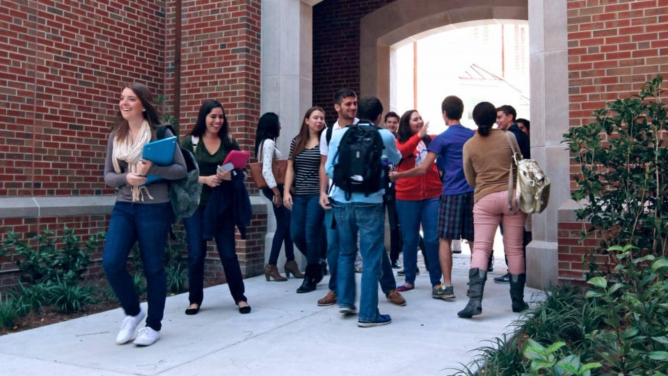 Heavener students between classes by Heavener Hall