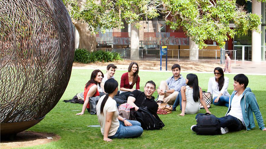 New South Wales students relaxing on the grass