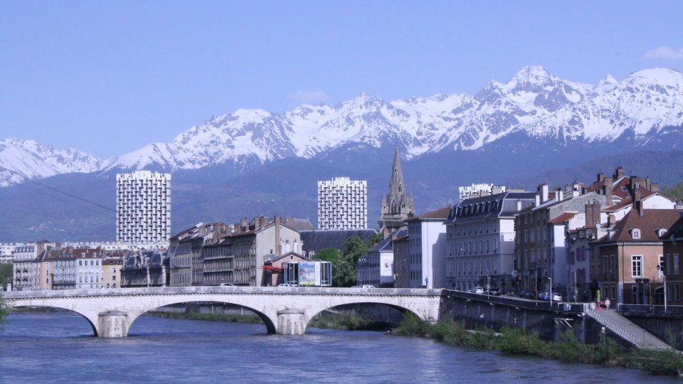 The city of Grenoble with the French Alps in the background