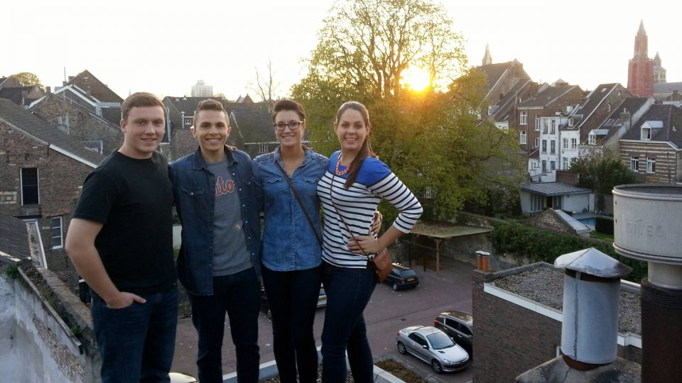 Students on a rooftop at sunset in Maastricht