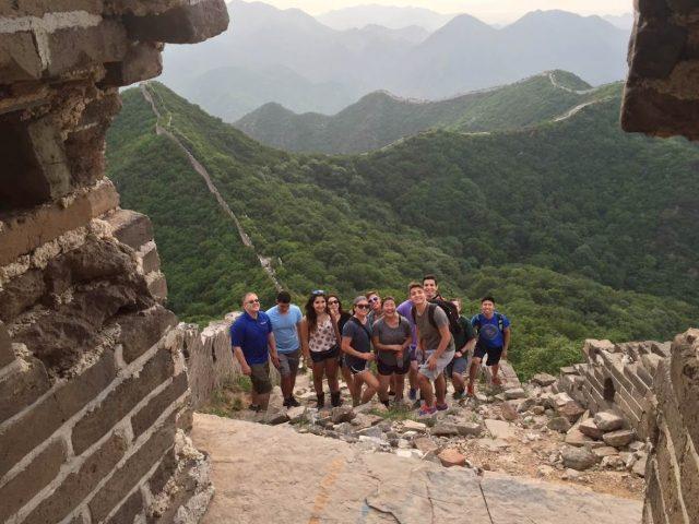 Jason Ward with students at the Great Wall of China