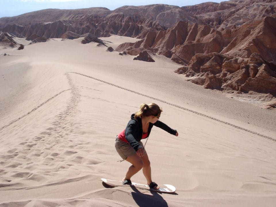 Sand boarding in the dunes of Chile