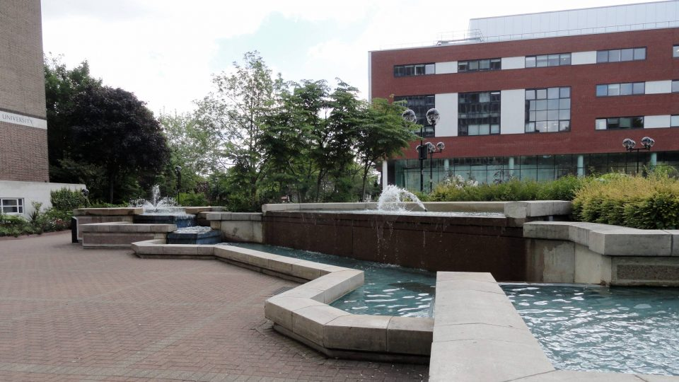 Fountains and buildings on Aston Business School campus, Birmingham, England
