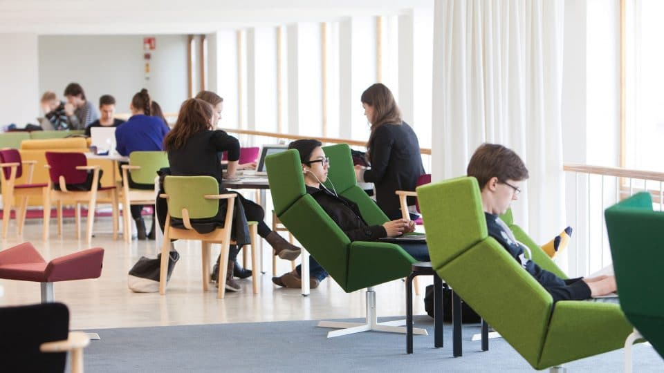 Students using the Aalto University learning hub in Helsinki, Finland