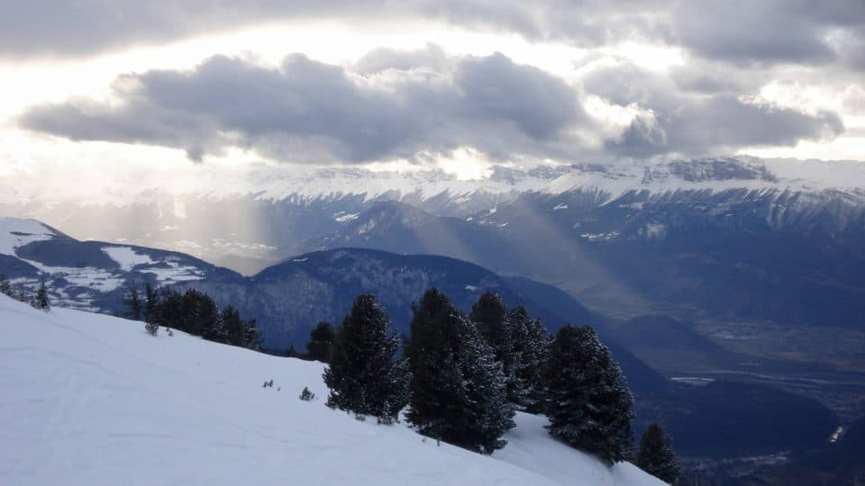 Sun rays through the clouds in the French Alps
