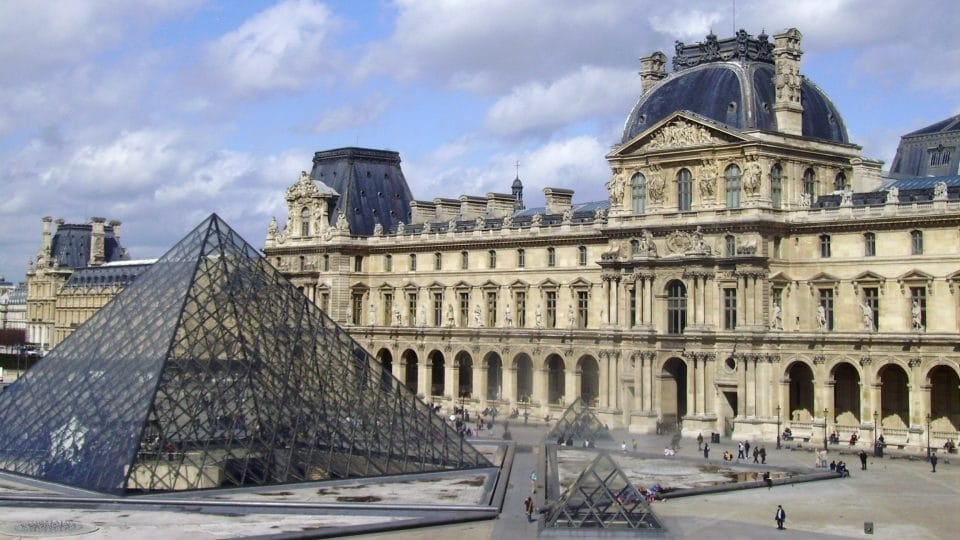The Louvre Museum and pyramid in Paris, France