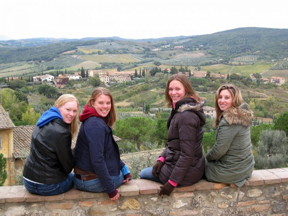 Four female students with Italian countryside in the background