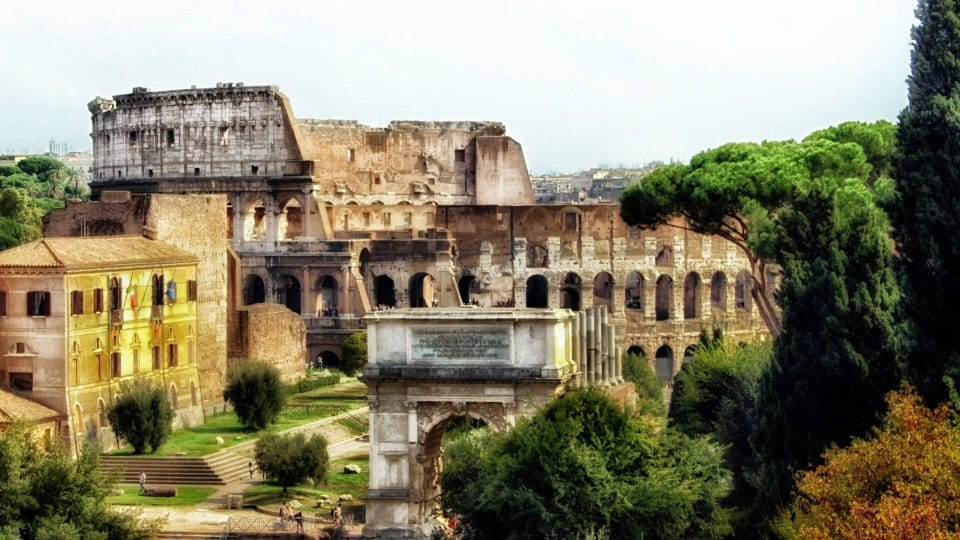 Ruins with the Colosseum in the background in Rome, Italy