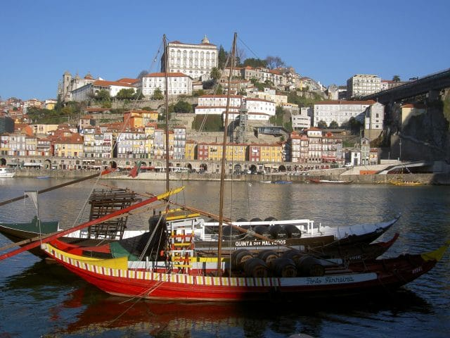 Boats on the Douro River with buildings in the background in Porto, Portugal