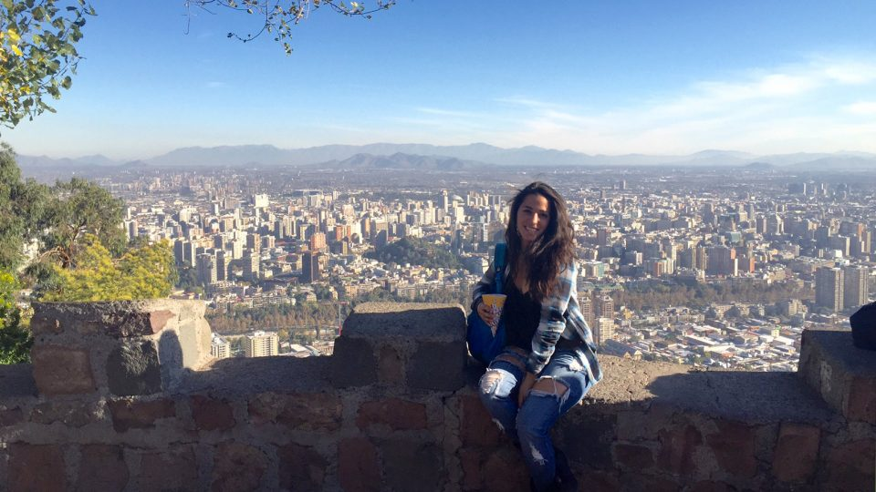 Young woman overlooking Santiago, Chile