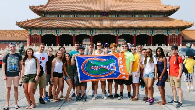 Students hold Gator flag in the Forbidden City, Beijing, China
