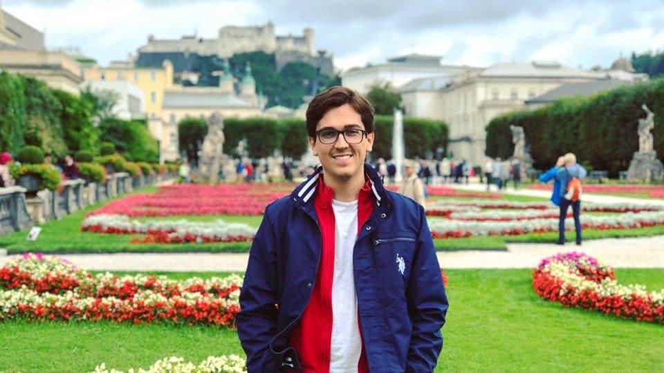 Student in front of Schloss Gardens in Austria.