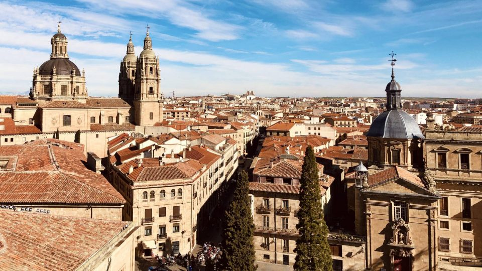 Rooftop view of the city of Salamanca Spain with a clear sky in the background.