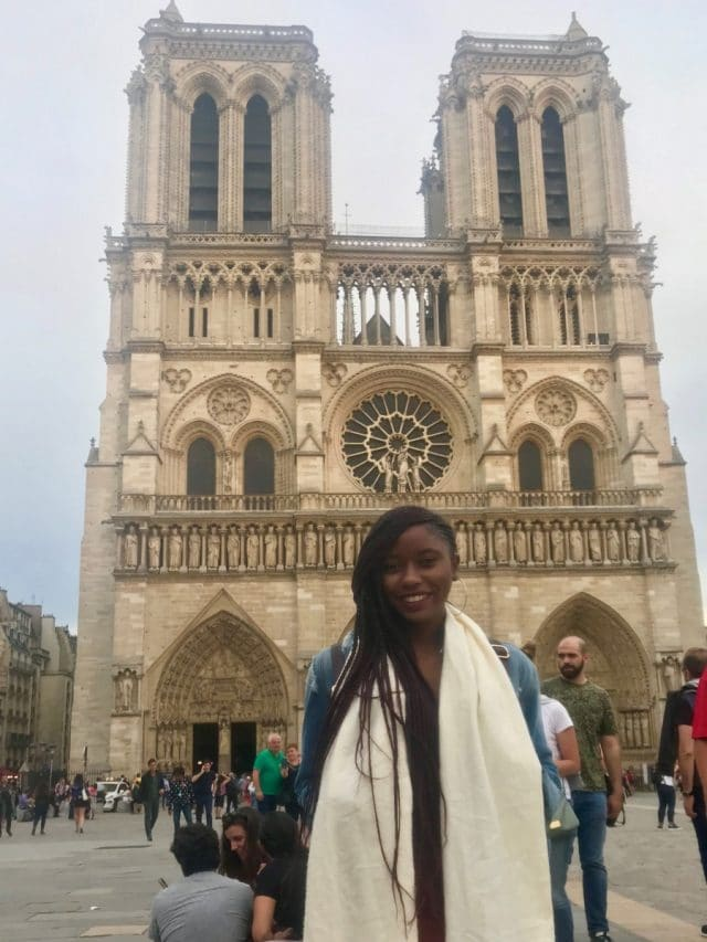 Student in front of Notre Dame in Paris, France