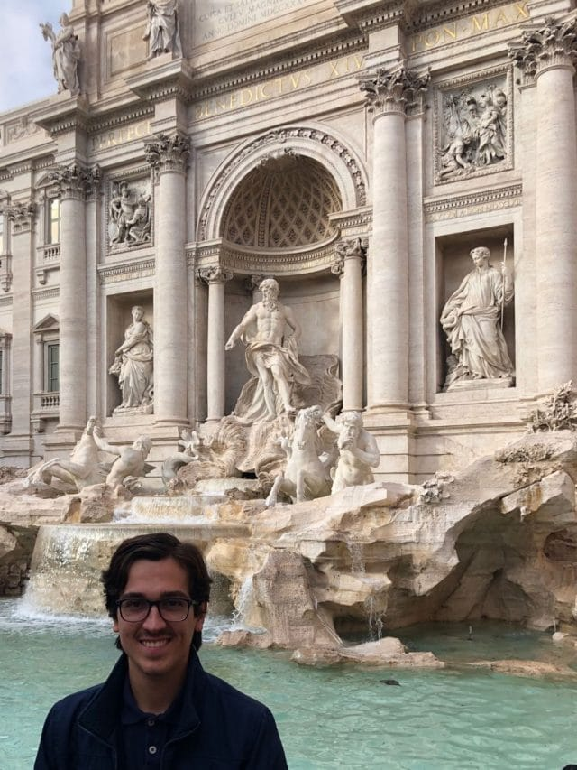 Trevi Fountain in Rome, Italy with student in front.