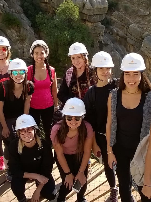 Group hiking with helmets in mountains of Asturias, Spain.