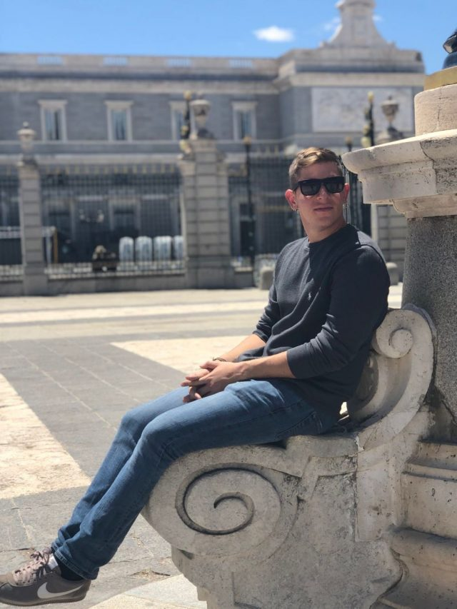 Student sitting outside of Palacio Real in Madrid, Spain